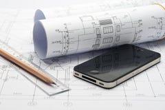 De tekening en iphone van het project Stock Afbeelding
