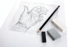 De tekening van de hand met hulpmiddelen Stock Foto