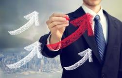 De tekening van de zakenman het toenemen pijlen Stock Fotografie