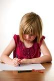 De tekening van het kind met haar kleurpotlood Stock Foto's