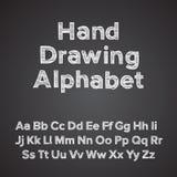 De tekeningsalfabet van de hand met krijteffect Stock Foto