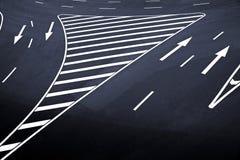 De tekens van de pijl op asfalt Royalty-vrije Stock Fotografie
