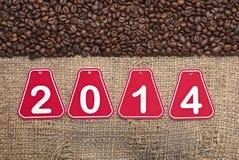 de tekst en de koffiebonen van 2014 Stock Fotografie