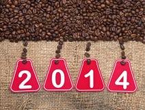 de tekst en de koffiebonen van 2014 Stock Afbeelding