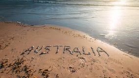De tekst van Australië op strand stock foto's