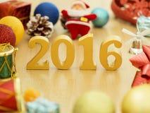 De tekst van goud 2016, maakt van hout Gouden jaar 2016 Nieuwe jaardecoratie, close-up op de tekst van 2016 Gelukkig Nieuwjaar 20 Royalty-vrije Stock Foto's