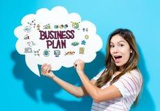 De tekst van het Businessplan met jonge vrouw die een toespraakbel houden Stock Foto
