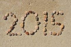 de tekst van 2015 op het strandzand Stock Fotografie