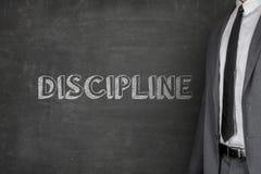 De Tekst van zakenmanstanding by discipline op Bord royalty-vrije stock foto