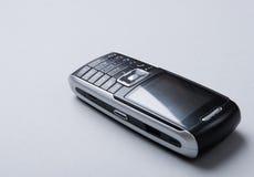 De telefoon van Cellural die op de grijze achtergrond wordt geïsoleerdm Stock Foto