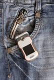 De telefoon van de cel in de zak royalty-vrije stock foto