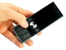 De telefoon van de cel in een hand stock foto