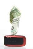 De telefoon van de cel met geld Stock Afbeeldingen