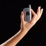 De telefoon van de de holdingscel van de hand Royalty-vrije Stock Afbeeldingen