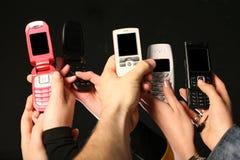 De telefoons van de cel in handen Stock Foto