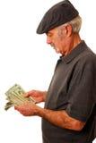 De tellende dollars van de mens Royalty-vrije Stock Foto