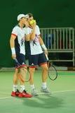 De tennisspelers Andy Murray L en Jamie Murray van Groot-Brittannië in actie tijdens mensen ` s verdubbelt eerste ronde gelijke v Stock Foto