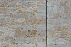 De textuur en het patroon van de zandsteenmuur Stock Foto