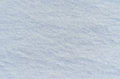 De textuur en de sneeuwachtergrond, sela ective nadruk, koekten sneeuw vlot en stevig wit royalty-vrije illustratie