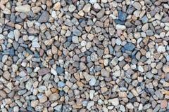 De textuur of de steenkiezelstenenachtergrond van steenkiezelstenen steenkiezelstenen voor binnenlands buitendecoratieontwerp Stock Fotografie