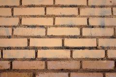 De textuur van de bakstenen muur is licht beige Stock Foto