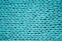 De textuur van blauw breit deken Het grote breien Plaid merinoswol Hoogste mening royalty-vrije stock afbeelding