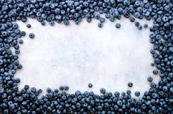 De textuur van bosbessenbessen sluit omhoog Grensontwerp Verse bosbessenachtergrond met exemplaarruimte voor uw tekst vegan Stock Fotografie
