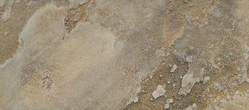 De textuur van bruin zolder-beton is een decoratieve deklaag voor muren Stock Afbeeldingen