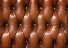 De textuur van de close-up van uitstekende bruine leerbank Stock Afbeelding