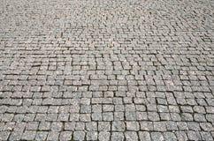 De textuur van de de wegbestrating van de steenstraat Stock Afbeeldingen
