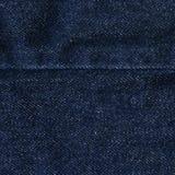 De Textuur van de denimstof - Donkerblauw met Naad Stock Foto