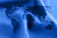 De textuur van de doek met wereldkaart Stock Foto