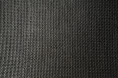 De textuur van de donkere stof Royalty-vrije Stock Afbeeldingen