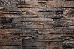 De textuur van de steen bruine muur natuurlijke kleur als achtergrond Royalty-vrije Stock Fotografie