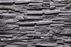 De textuur van de steen grijze muur natuurlijke kleur als achtergrond Royalty-vrije Stock Foto's