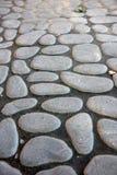 De textuur van de steenbestrating Het graniet cobblestoned bestratingsachtergrond stock foto's