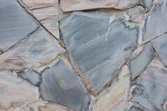 De textuur van de steenmuur natuurlijke kleur als achtergrond Royalty-vrije Stock Foto
