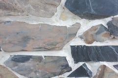De textuur van de steenmuur natuurlijke kleur als achtergrond Stock Foto's