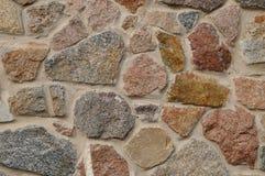 De textuur van de steenmuur natuurlijke kleur als achtergrond Stock Afbeeldingen