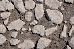 De textuur van de stenen en de natte aarde Royalty-vrije Stock Afbeelding