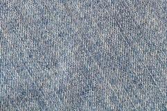 De textuur van de denimstof zonder een naad Stock Foto's