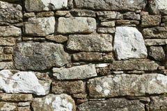 De textuur van de Drystonemuur, in een regelmatig patroon stock fotografie