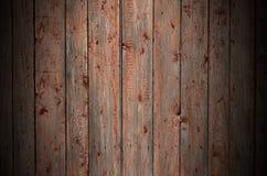 De textuur van een oude rustieke houten die omheining van vlak verwerkte raad wordt gemaakt Gedetailleerd beeld van een straatomh royalty-vrije stock afbeelding