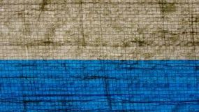 De textuur van een stuk van zelfklevend document dat door regen wordt gewassen stock foto