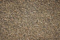 De textuur van het kiezelsteenstrand Stock Afbeelding