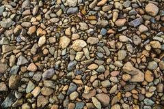 De Textuur van het kleurengrint Kleine rode stenen Stock Foto