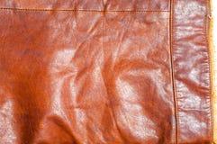 De textuur van het leerjasje, achtergrond met decoratieve strepen stock foto