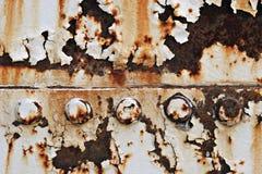 De textuur van het metaal met bouten Stock Foto's
