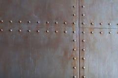 De textuur van het metaal met klinknagels Royalty-vrije Stock Foto