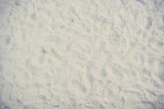 De textuur van het zand Bruin zand Achtergrond van fijn zand Gele kleurenversie Stock Fotografie